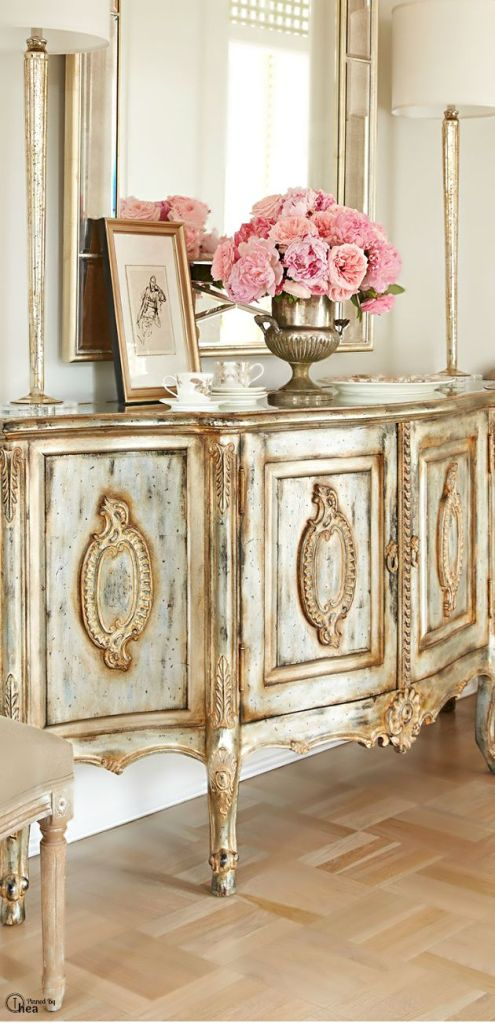 Pink Flowers on an Elegant Sideboard